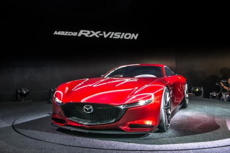 "new mazda rx vision rotary A time to rejoice then, that there's still room for freedom of expression in an increasingly homogenised car industry. The RX-Vision is a two-door, two-seater sports coupe that previews a successor to the RX-8 – and will bring back the RX-7 name for the fourth time in Mazda's history. If it can overcome the financial and technical hurdles to actually make it to the showroom, that is. ""Will it be called RX-9? Well, all previous RX-7s have been two or 2+2 seaters and the RX-8 was a four-seater, so what would that make RX-9? A six-seater? This concept is a two-seater so you can imagine which number fits best,"" Kiyoshi Fujiwara, Mazda's head of R&D told us at the Tokyo show. The RX family's front-engine, rear-wheel drive formula is untinkered with, but what's under the hood is box fresh. It's a ""next generation"" rotary engine christened SKYACTIV-R that Mazda says addresses the three perennial stumbling blocks for Wankel engines: economy, emissions and reliability."